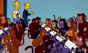 Scimmie con macchine da scrivere